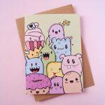 Gevouwen kaart met vrolijke monsters zonder tekst