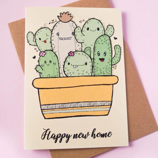 Gevouwen kaart met vrolijke cactussen met tekst 'Happy new home'